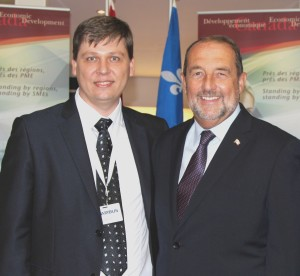 L-R: Taras Paslavskyi, YPSWA Treasurer and Jacques Daoust, Quebec Minister of the Economy, Innovations and Exports